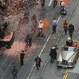 Giants Manager Bruce Bochy holds up the World Series trophy for fans lining Market Street for the victory parade on Market Street in San Francisco, Calif. on Wednesday, Oct. 31, 2012.