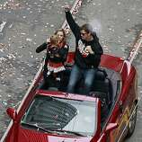 Pitcher Matt Cain rides in the Giants' World Series victory parade with his family in San Francisco, Calif. on Wednesday, Oct. 31, 2012.