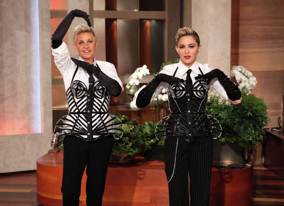 "Madonna is now hiding her face behind a mask during interviews ""if you ask me a question that I feel uncomfortable with,"" she told talk show host Ellen Degeneres. ""This is going to be a sign that I don't want to answer the question."" We can't wait to try this technique at the next staff meeting. Photo: Michael Rozman, Associated Press / Warner Bros."