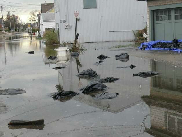 Parts of Fairfield Beach Road remained impassable Wednesday afternoon, blocked by water or sand. Photo: Genevieve Reilly