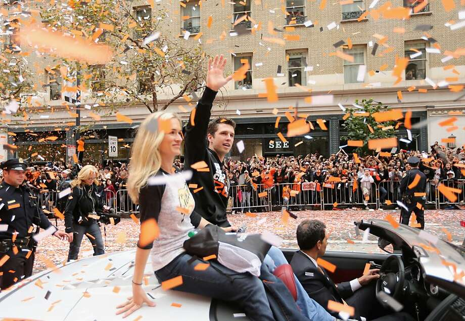 Buster Posey #28 of the San Francisco Giants waves to the crowd during the San Francisco Giants World Series victory parade on October 31, 2012 in San Francisco, California. The San Francisco Giants beat the Detroit Tigers to win the 2012 World Series. Photo: Ezra Shaw, Getty Images