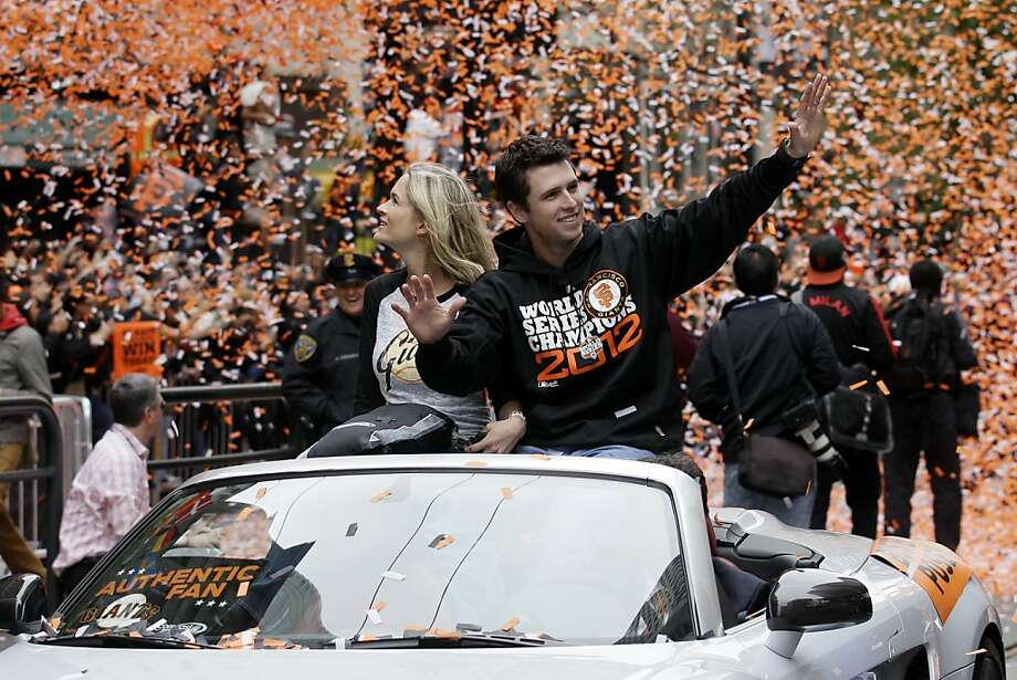 San Francisco Giants catcher Buster Posey and his wife Kristen ride in a car as confetti falls during the baseball team's World Series victory parade, Wednesday, Oct. 31, 2012, in San Francisco. (AP Photo/Jeff Chiu) Photo: Jeff Chiu, Associated Press