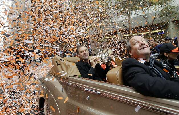 San Francisco Giants manager Bruce Bochy holds the World Series trophy as confetti falls during the baseball team's World Series victory parade, Wednesday, Oct. 31, 2012 in San Francisco.(AP Photo/Jeff Chiu) Photo: Jeff Chiu, Associated Press