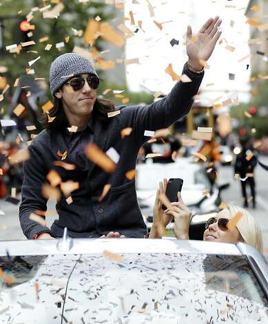 San Francisco Giants pitcher Tim Lincecum acknowledges fans during the baseball team's World Series victory parade, Wednesday, Oct. 31, 2012, in San Francisco. Photo: Marcio Jose Sanchez, Associated Press