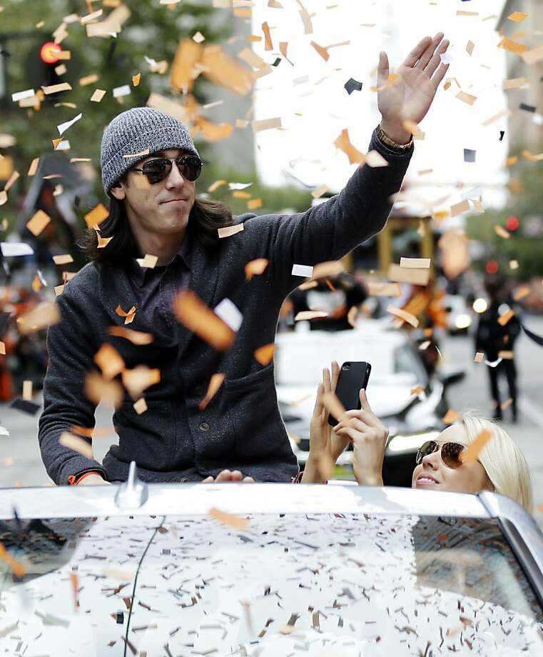 San Francisco Giants pitcher Tim Lincecum acknowledges fans during the baseball team's World Series victory parade, Wednesday, Oct. 31, 2012, in San Francisco. (AP Photo/Marcio Jose Sanchez) Photo: Marcio Jose Sanchez, Associated Press