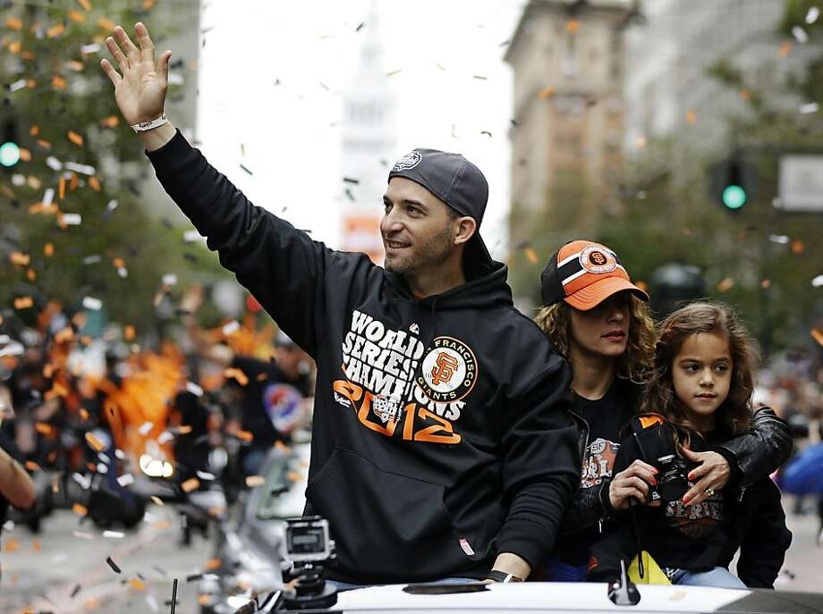 San Francisco Giants' Marco Scutero, his wife Marines and their daughter Valeria ride in a car during the baseball team's World Series victory parade, Wednesday, Oct. 31, 2012, in San Francisco. (AP Photo/Marcio Jose Sanchez) Photo: Marcio Jose Sanchez, Associated Press