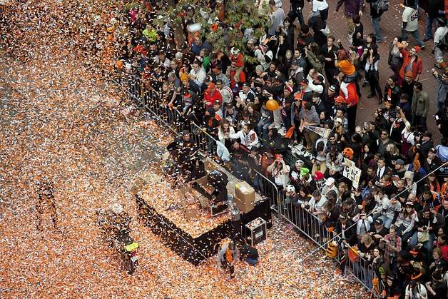 Confetti rains down on people lining Market Street during the San Francisco Giants' World Series victory parade, Wednesday, Oct. 31, 2012, in San Francisco. The parade for the team's second baseball championship in three years went along Market Street and ended with a celebration in front of City Hall. (AP Photo/Eric Risberg) Photo: Eric Risberg, Associated Press