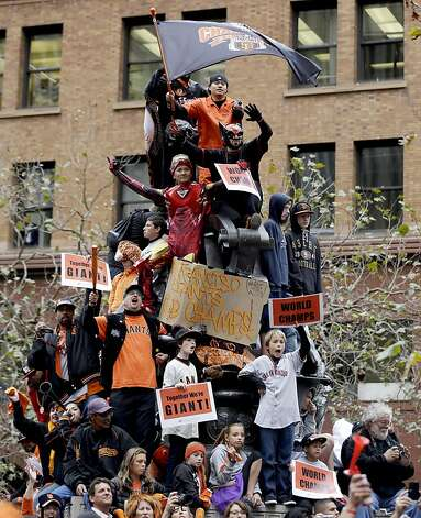 San Francisco Giants fans cheer during the team's World Series baseball victory parade, Wednesday, Oct. 31, 2012 in San Francisco. (AP Photo/Marcio Jose Sanchez) Photo: Marcio Jose Sanchez, Associated Press