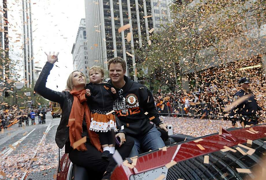 San Francisco Giants pitcher Matt Cain, his wife, Chelsea, and daughter Hartley ride in a car as confetti falls during the baseball team's World Series victory parade, Wednesday, Oct. 31, 2012, in San Francisco.(AP Photo/Marcio Jose Sanchez) Photo: Marcio Jose Sanchez, Associated Press