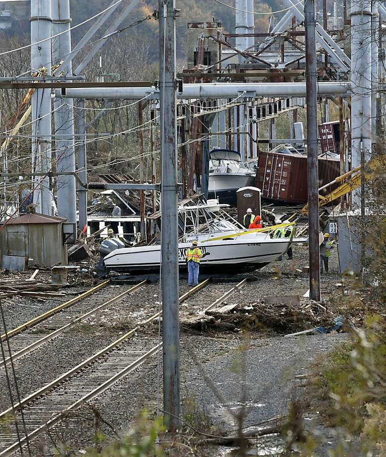 Mainline mess:New Jersey transit officials say the Coast Line, which provides train service from shore towns to New York City, may experience prolonged disruption due to powerboats on the tracks. (South Amboy, N.J.) Photo: Mel Evans, Associated Press