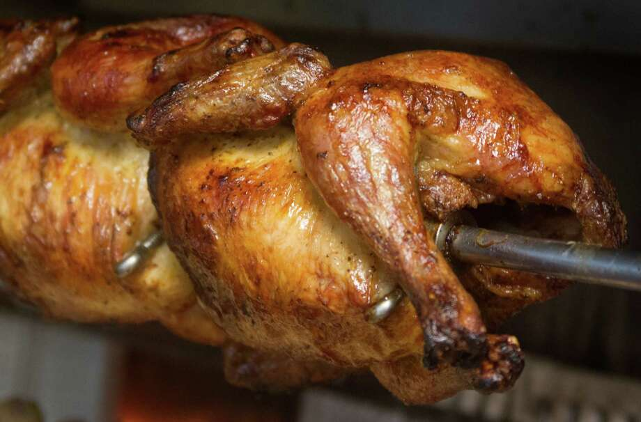 Rotisserie chickens are flavored with a Peruvian spice rub that is irresistible. Photo: J. Patric Schneider, Freelance / Houston Chronicle