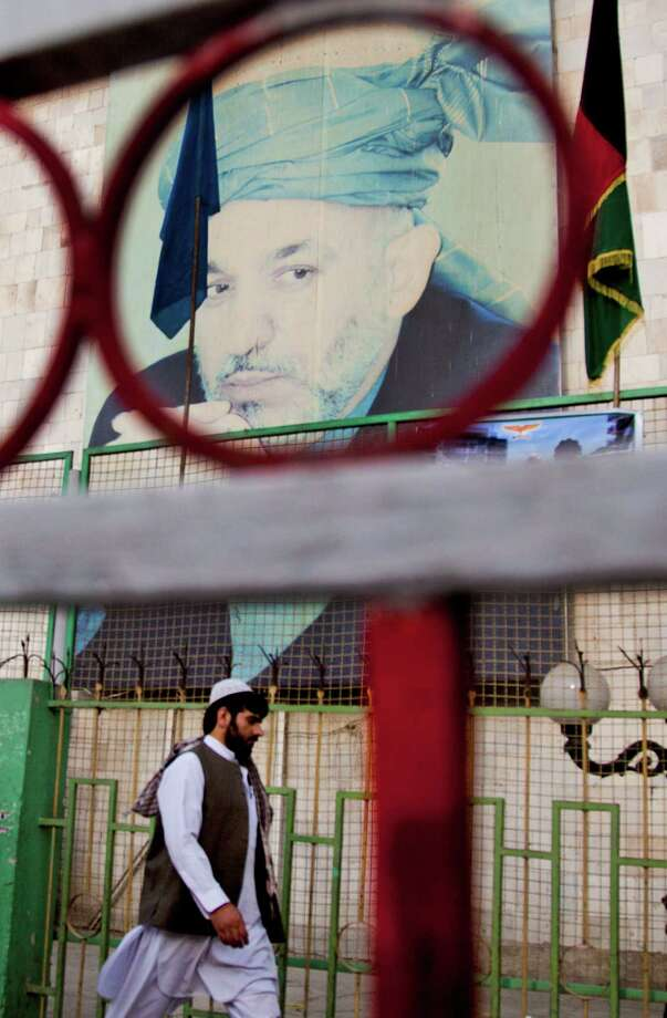 While President Hamid Karzai is barred from running in 2014, his presence is expected to be felt. Photo: Anja Niedringhaus, STF / AP