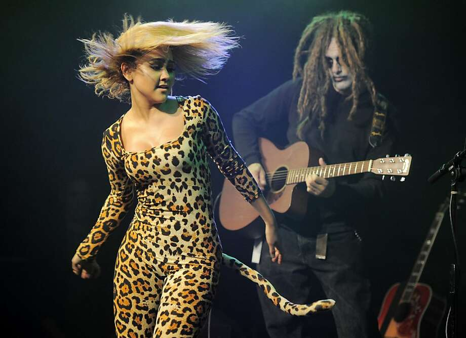 Fab feline Kat DeLuna flips her mane and shakes her tail during the KIIS FM Halloween Party benefit at the House of Rock in Santa Monica, Calif. Photo: Chris Pizzello, Associated Press