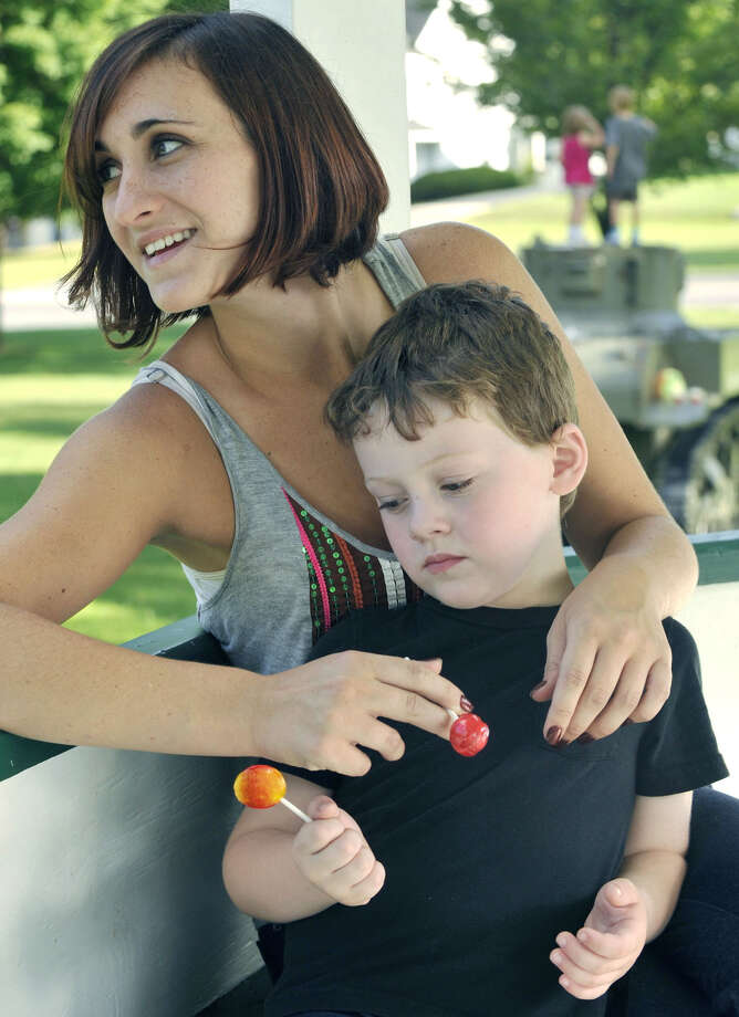 Megan McSherry and her son, Ethan, relax on the bandstand on the New Milford Village Green, Sept. 5, 2012. Photo: Jason Rearick