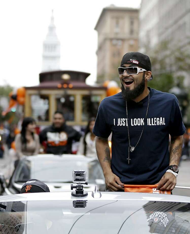 Giants relief pitcher Sergio Romo displays a message on his shirt that drew much attention at Wednesday's festivities. Photo: Marcio Jose Sanchez, Associated Press