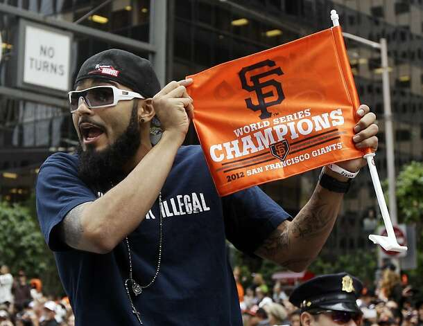 San Francisco Giants pitcher Sergio Romo holds up a flag during the baseball team's World Series victory parade, Wednesday, Oct. 31, 2012, in San Francisco. (AP Photo/Jeff Chiu) Photo: Jeff Chiu, Associated Press