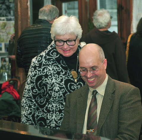 Ruth Henderson shares a relaxed moment with pianist with Hank Milligan during a gallery opening at The Silo in October 2011.  Courtesy of The Silo Photo: Contributed Photo