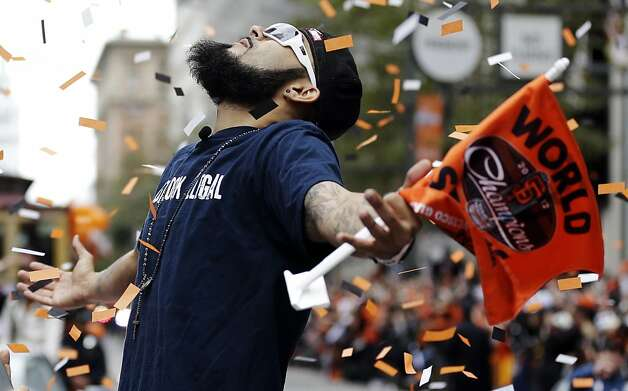 San Francisco Giants pitcher Sergio Romo looks up as confetti falls during the baseball team's World Series victory parade, Wednesday, Oct. 31, 2012, in San Francisco. (AP Photo/Marcio Jose Sanchez) Photo: Marcio Jose Sanchez, Associated Press