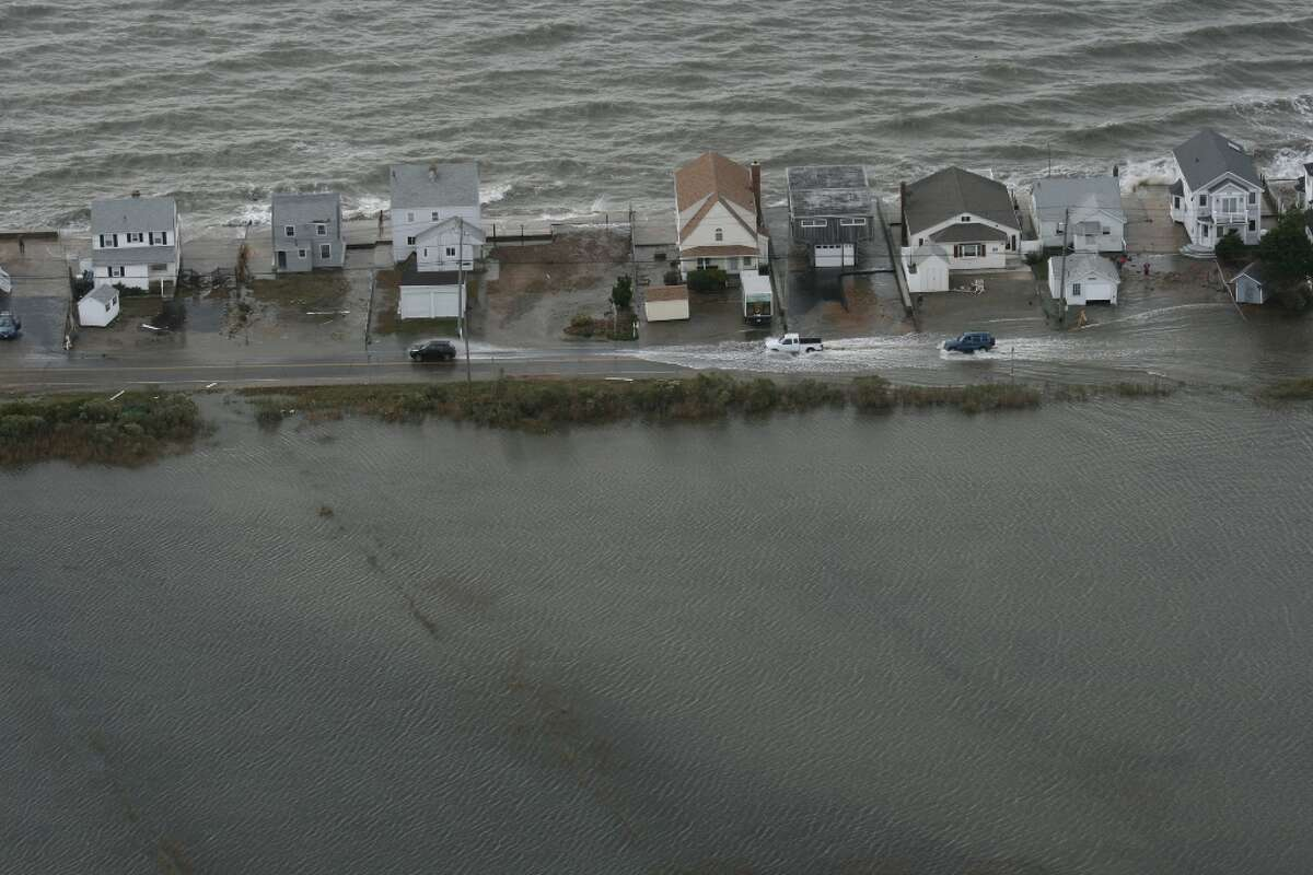 A Connecticut National Guard photographer took this photo during an aerial assessment of damage caused along the shoreline by Hurricane Sandy in 2012. Click through to see photos of some of the worst hurricanes to have landed in the state.