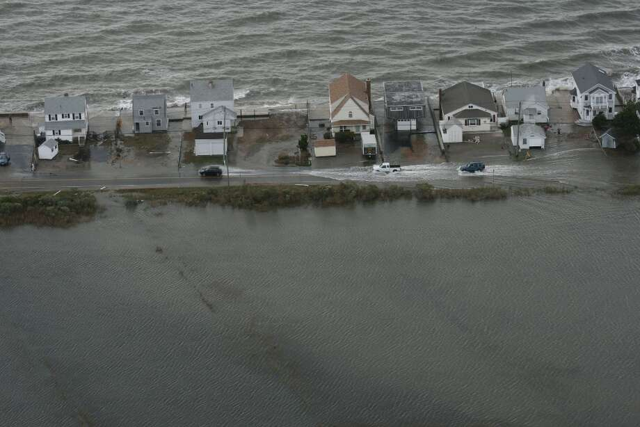 A Connecticut National Guard photographer took this photo during an aerial assessment of damage caused along the shoreline by Hurricane Sandy in 2012. Click through to see photos of some of the worst hurricanes to have landed in the state. Photo: Connecticut National Guard, Contributed Photo / Connecticut Post Contributed