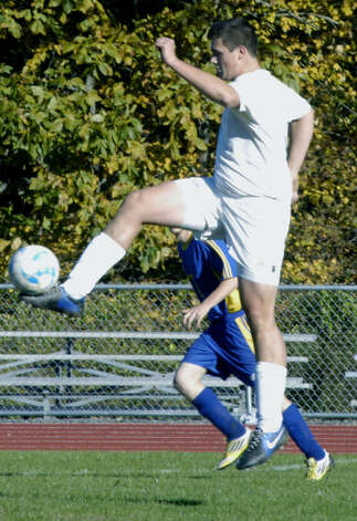 Peyton Kay of the Spartans soars to gain possession during the Shepaug Valley High School boys'soccer match vs. Gilbert, Oct. 11, 2012 in Washington. Photo: Norm Cummings