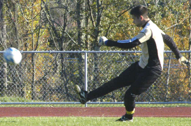 Veteran goalkeeper Kellen Rikhoff  boots a powerful clearing pass during the Shepaug Valley High School boys'soccer match vs. Gilbert, Oct. 11, 2012 in Washington. Photo: Norm Cummings