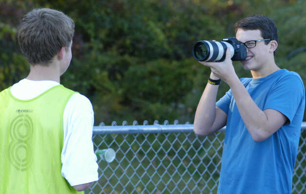 Shepaug sophomore Liam Kay captures images of the Spartan players during the Shepaug Valley High School boys' soccer match vs. Gilbert, Oct. 11, 2012 in Washington. Photo: Norm Cummings