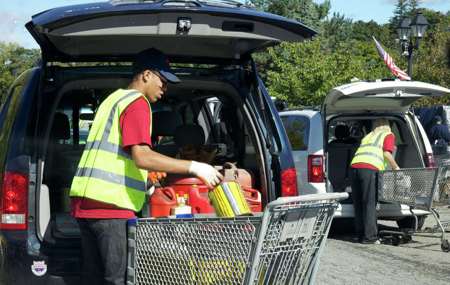 Items are removed from participating vehicles during Sept. 15's hazardous waste collection day at Patriot's Way in New Milford. Photo: Trish Haldin