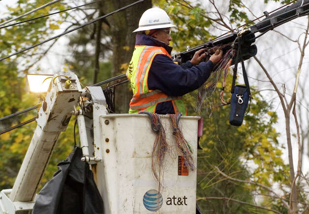 An AT&T line crew works above Wooster Street in Danbury on Wednesday, Oct. 31, 2012. Photo: Jason Rearick, Connecticut Post / The News-Times