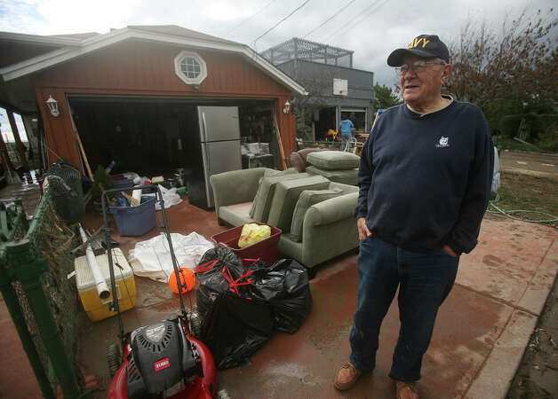 Ed Berberich emptied his home of furniture before cleaning up from the flood waters of Hurricane Sandy on Point Beach Drive in Milford on Wednesday, October 31, 2012. Photo: Brian A. Pounds, Connecticut Post / Connecticut Post