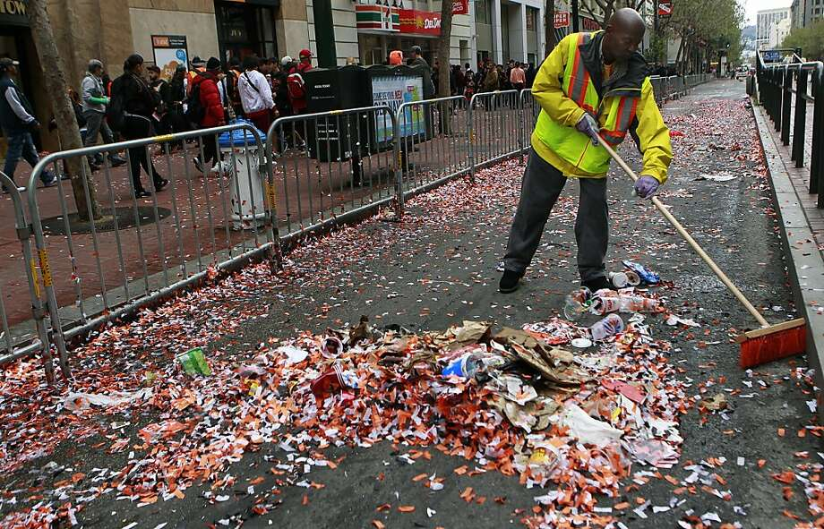 A Department of Public Works employee cleans up loads of confetti after the Giants World Series victory parade. Photo: Paul Chinn, The Chronicle