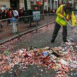 A Department of Public Works employee cleans up loads of confetti after the Giants World Series victory parade.