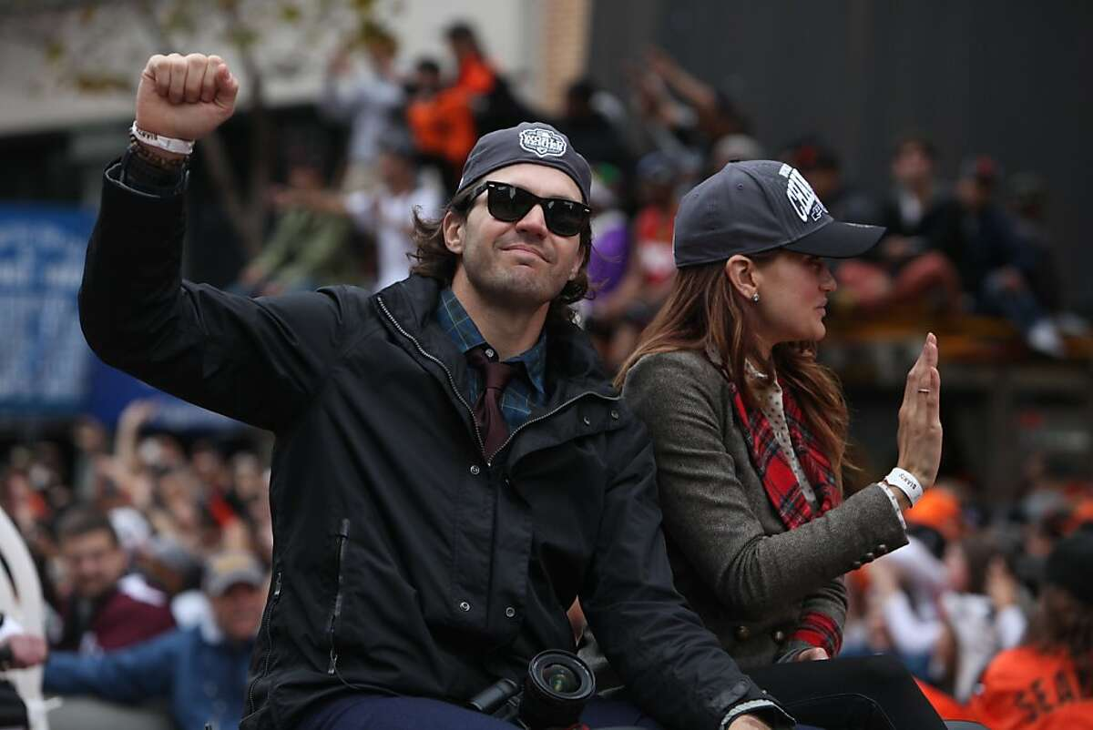 Giants pitcher Barry Zito (left) pumps his fist as he rides along the parade route during the San Francisco Giants World Series victory parade on Wednesday, October 31, 2012 in San Francisco, Calif.