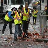 A DPW crew cleans up Market Street after the Giants' World Series victory parade in San Francisco, Calif. on Wednesday, Oct. 31, 2012.