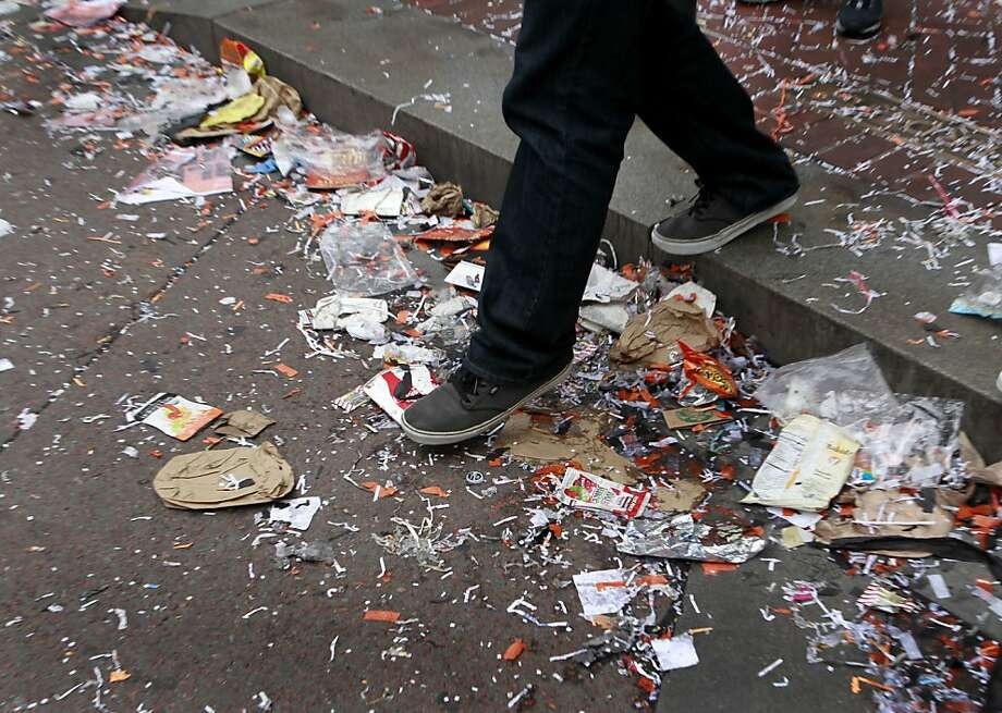 A man crosses Third Street while DPW crews work to cleanup and reopen Market Street after the Giants' World Series victory parade in San Francisco, Calif. on Wednesday, Oct. 31, 2012. Photo: Paul Chinn, The Chronicle