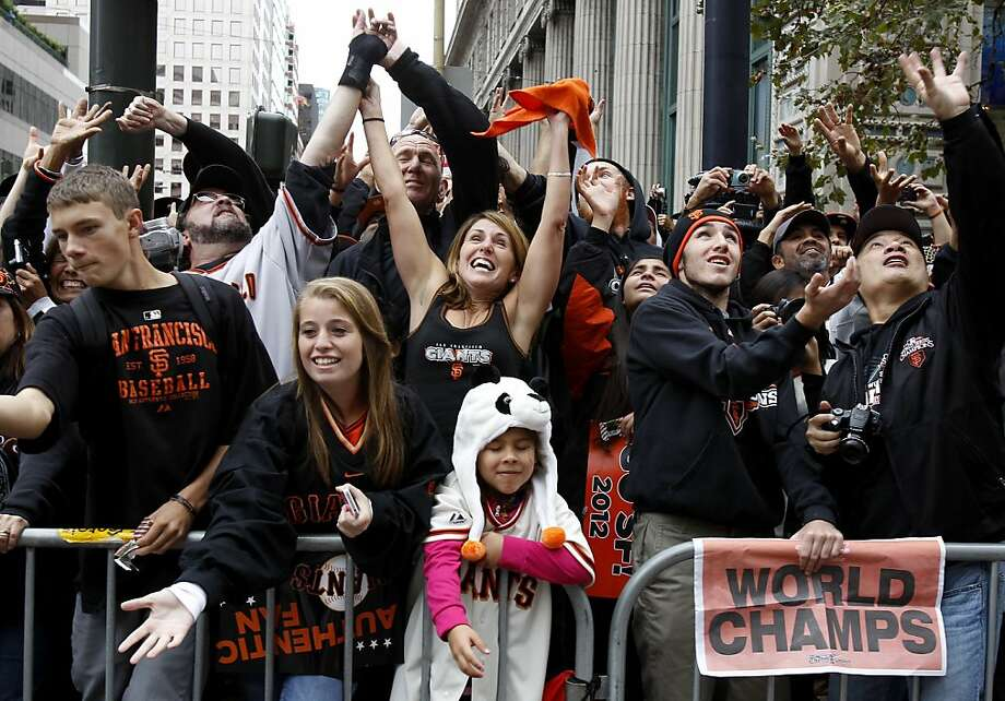 Fans reacted to candy being thrown there way early in the parade. The San Francisco Giants celebrated their second World Series title in three years with a parade down Market Street Wednesday October 31, 2012. Photo: Brant Ward, The Chronicle