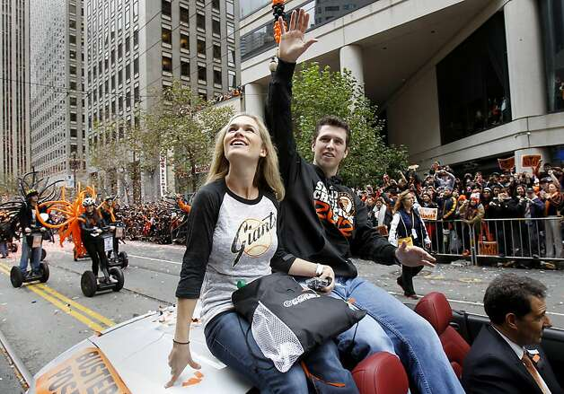 Buster Posey and his wife Kristen waved to the crowds of fans. The San Francisco Giants celebrated their second World Series title in three years with a parade down Market Street Wednesday October 31, 2012. Photo: Brant Ward, The Chronicle