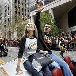 Buster Posey and his wife Kristen waved to the crowds of fans. The San Francisco Giants celebrated their second World Series title in three years with a parade down Market Street Wednesday October 31, 2012.