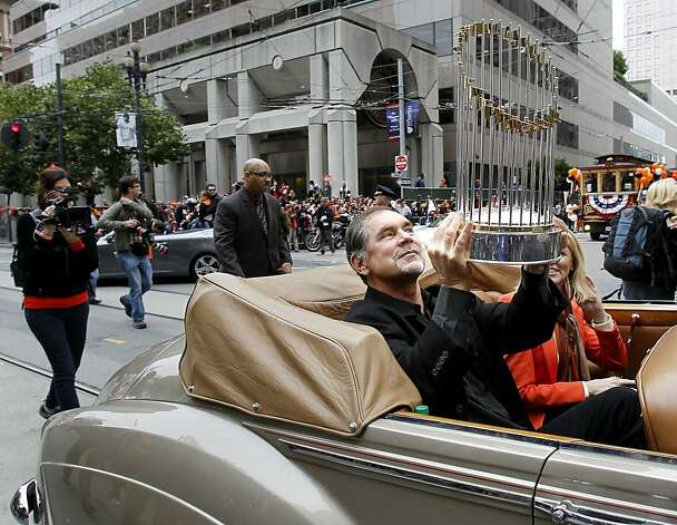 Giants manager Bruce Bochy held the World Series trophy on his lap as he rode down Market Street. The San Francisco Giants celebrated their second World Series title in three years with a parade down Market Street Wednesday October 31, 2012. Photo: Brant Ward, The Chronicle