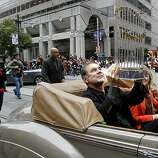 Giants manager Bruce Bochy held the World Series trophy on his lap as he rode down Market Street. The San Francisco Giants celebrated their second World Series title in three years with a parade down Market Street Wednesday October 31, 2012.