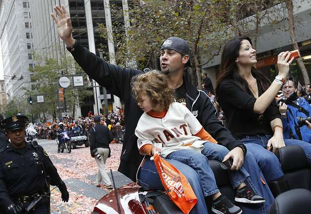Ryan Vogelsong and his family waved to the appreciative crowd. The San Francisco Giants celebrated their second World Series title in three years with a parade down Market Street Wednesday October 31, 2012. Photo: Brant Ward, The Chronicle