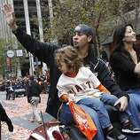Ryan Vogelsong and his family waved to the appreciative crowd. The San Francisco Giants celebrated their second World Series title in three years with a parade down Market Street Wednesday October 31, 2012.