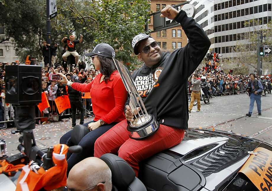 Pablo Sandoval and Kseniya Blayakherova shared the backseat with his MVP trophy. The San Francisco Giants celebrated their second World Series title in three years with a parade down Market Street Wednesday October 31, 2012. Photo: Brant Ward, The Chronicle