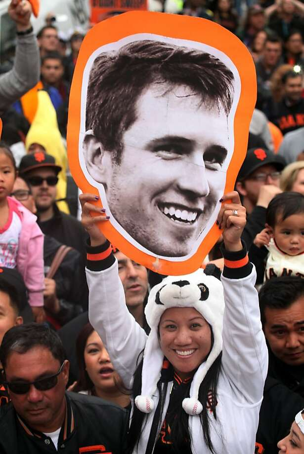 Deb Penafor hold a large picture of Buster Posey as she watches the San Francisco Giants World Series victory parade on Wednesday, October 31, 2012 in San Francisco, Calif. Photo: Lea Suzuki, The Chronicle