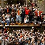 Fans filled the sidewalks and struggled as best they could to see their heroes on the Giants - and take lots of pictures - during the victory parade.
