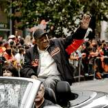 Giants' great Willie Mays waves to fans as the San Francisco Giants celebrate their World Series Championship with a parade up Market Street in downtown San Francisco, Calif., on Wednesday Oct. 31, 2012.