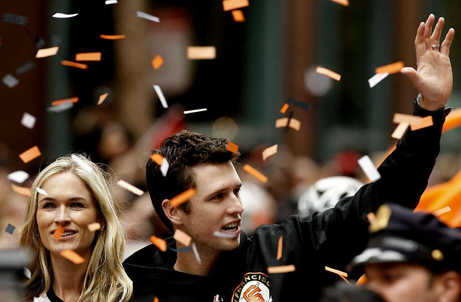 San Francisco Giants' Buster Posey and his wife Kristen wave to fans as the San Francisco Giants celebrate their World Series Championship with a parade up Market Street in downtown San Francisco, Calif., on Wednesday Oct. 31, 2012. Photo: Michael Macor, The Chronicle