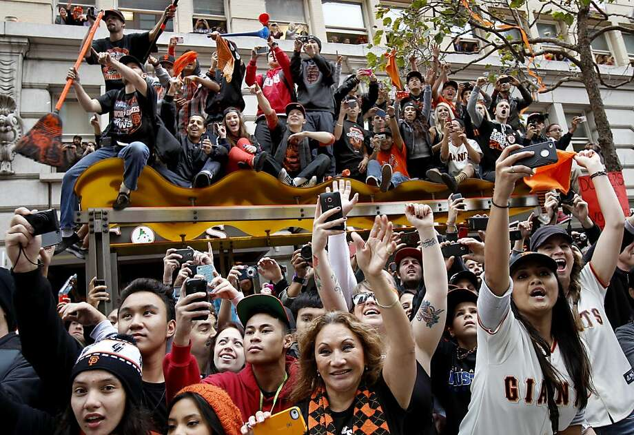 Fans on Market Street pulled out their camera phones as there heroes passed by. The San Francisco Giants celebrated their second World Series title in three years with a parade down Market Street Wednesday October 31, 2012. Photo: Brant Ward, The Chronicle