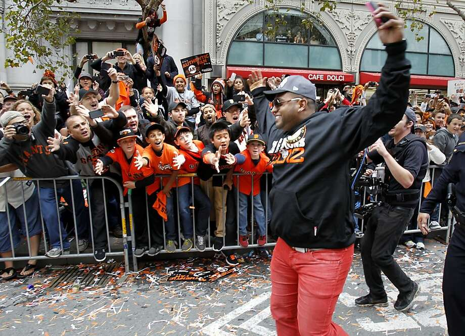 Pablo Sandoval greeted the fans after departing from his parade car on Market Street. The San Francisco Giants celebrated their second World Series title in three years with a parade down Market Street Wednesday October 31, 2012. Photo: Brant Ward, The Chronicle