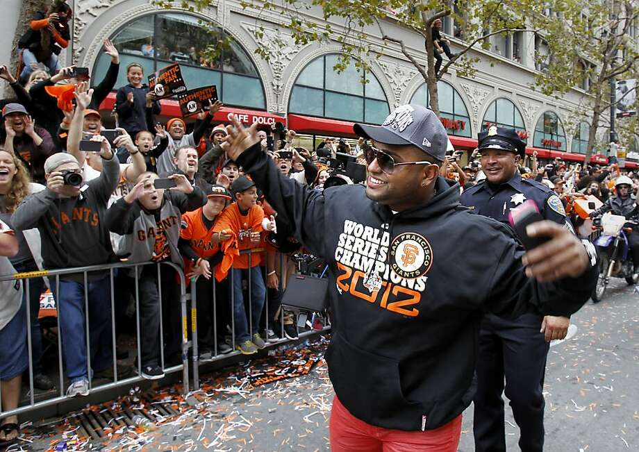Pablo Sandoval departed from his parade car to greet the fans on Market Street. The San Francisco Giants celebrated their second World Series title in three years with a parade down Market Street Wednesday October 31, 2012. Photo: Brant Ward, The Chronicle